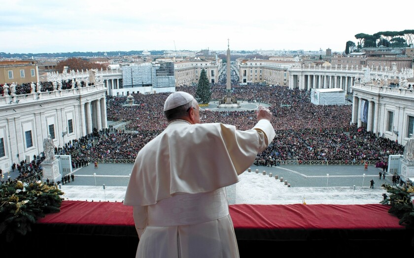 Pope Francis gives a Christmas blessing from the balcony of St. Peter's Basilica at the Vatican.