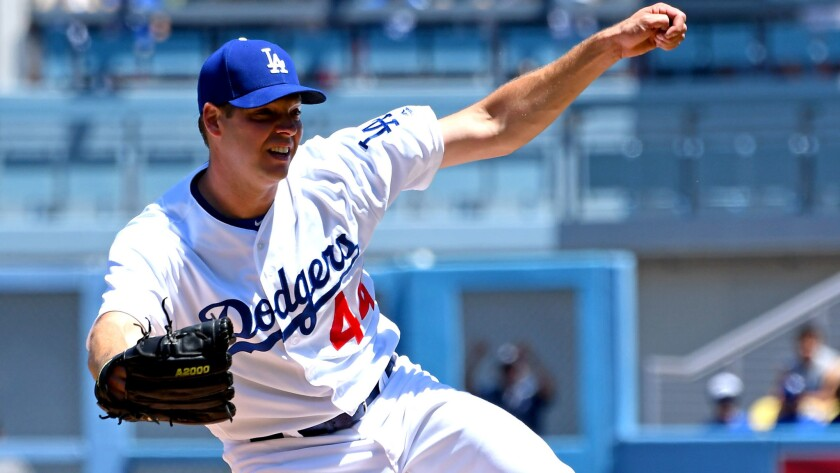 Dodgers starter Rich Hill follows through on a pitch against the Diamondbacks during the first inning Sunday.