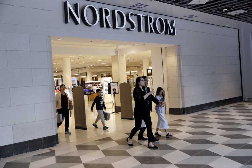 """In this Aug. 23, 2017, photo, shoppers exit a Nordstrom store in San Jose, Calif. Department store operator Nordstrom said Monday, March 5, 2018, it had rejected a takeover offer from members of the Nordstrom family, calling the price """"inadequate."""""""