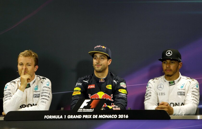 Red Bull driver Daniel Ricciardo of Australia, center, speaks with the media, during a press conference, after winning the qualification, at the Monaco racetrack, in Monaco, Saturday, May 28 2016. Second places Mercedes driver Nico Rosberg of Germany sits at left and third placed Mercedes driver Le
