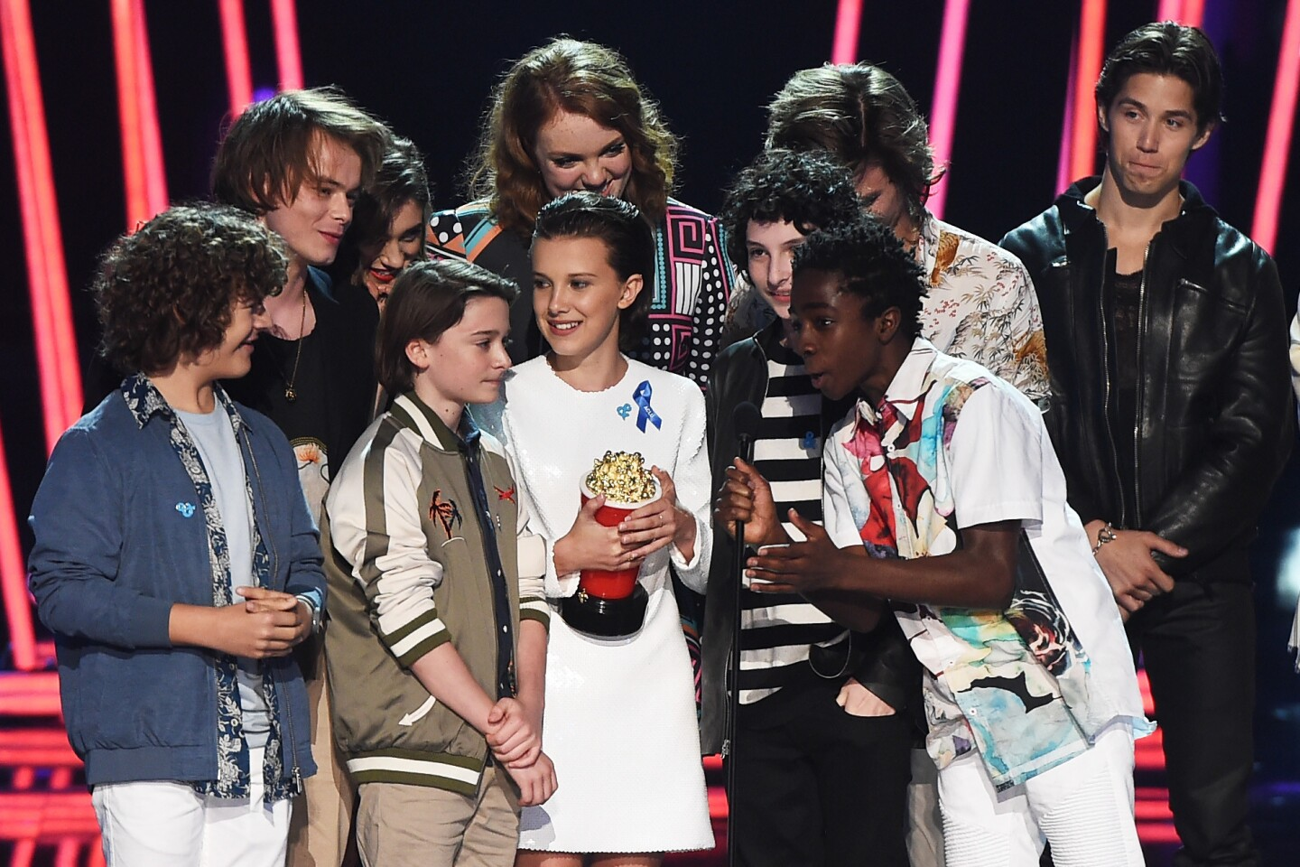"""The cast of """"Stranger Things"""" accepts Show of the Year award during the 2017 MTV Movie & TV Awards at the Shrine Auditorium in Los Angeles."""
