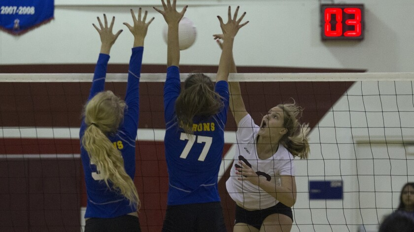 Laguna Beach High's Soren Patchell, right, battles at the net against Fountain Valley in the first s