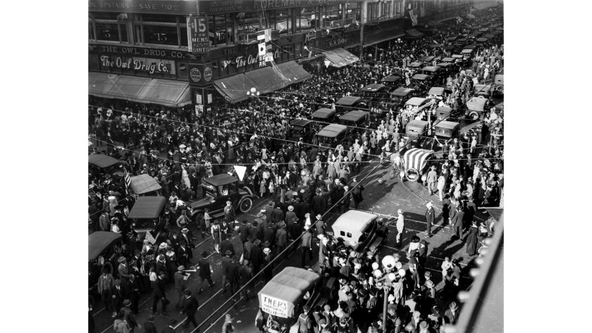 Nov. 11, 1918: At Fifth and Broadway traffice moved at a crawl as thousands jammed streets blocking