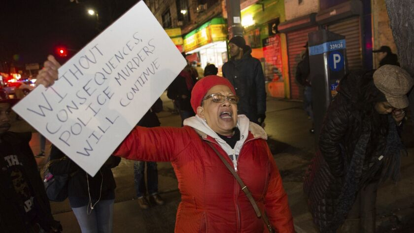 People protest after police officers shot and killed a man in Brooklyn, N.Y., on April 4.