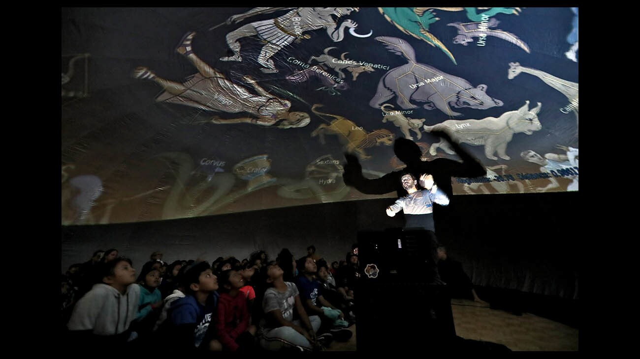 Photo Gallery: Oak View Elementary students view sky under mobile planetarium