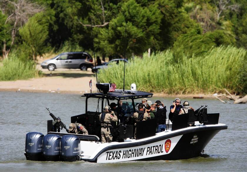 A group of Republican House members led by Rep. Michael McCaul of Texas takes a police boat ride to examine border security operations in Mission, Texas.