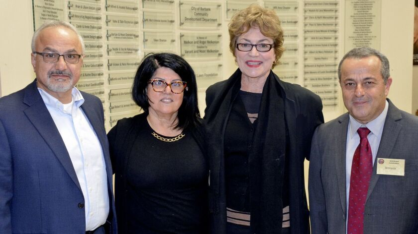 Burbank Vice Mayor Sharon Springer, second from right, was welcomed to Monday's Armenian Christmas c