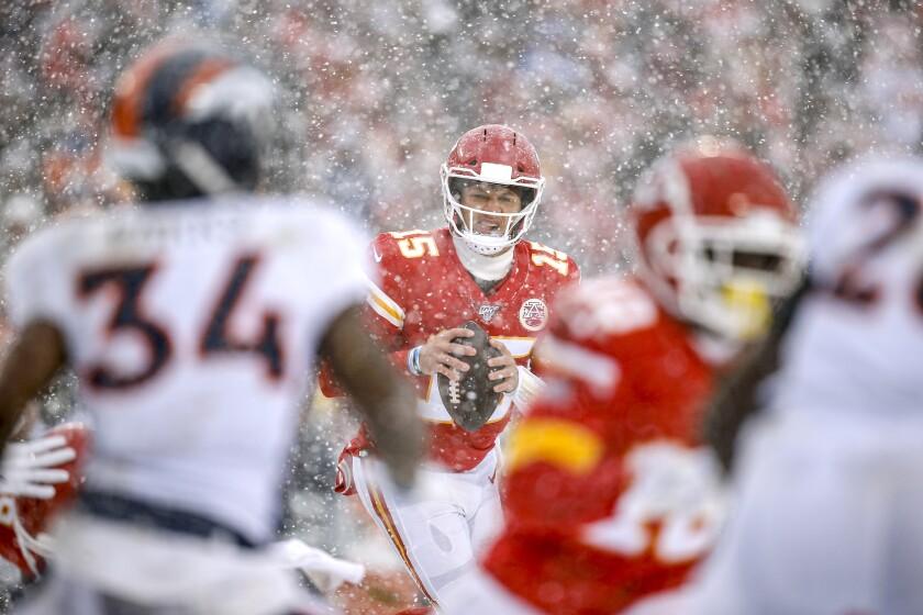Kansas City Chiefs quarterback Patrick Mahomes looks to pass during the third quarter against the Denver Broncos.