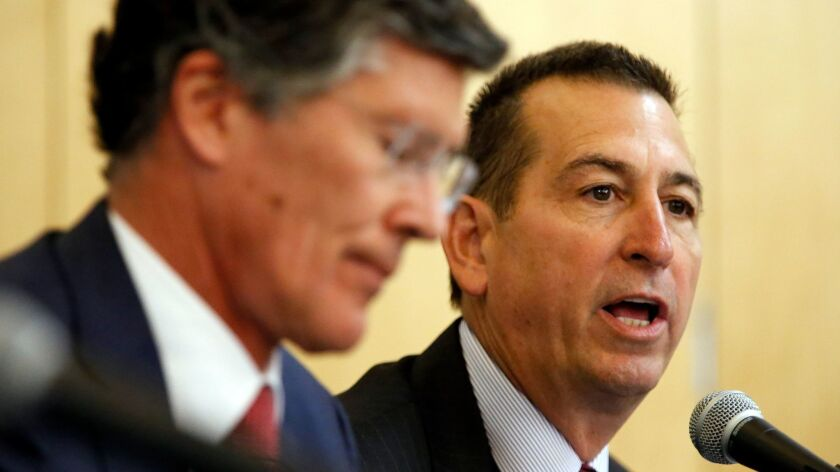 Joseph Otting, right, then chief executive of OneWest Bank, speaks at a 2015 hearing in Los Angeles, regarding the bank's purchase by CIT Group.