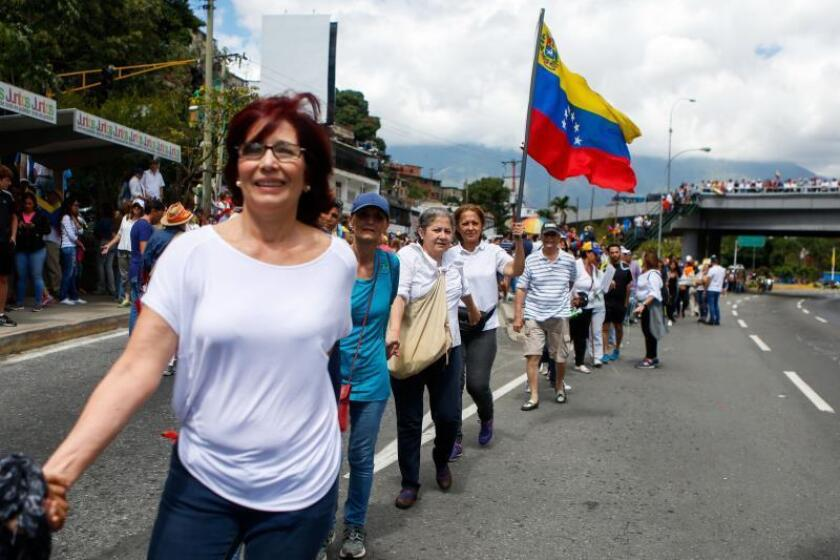 Venezuelan opposition supporters participate in a protest in Caracas on Jan. 30, 2019, demanding an end to the country's political and economic crisis and showing support for National Assembly President Juan Guaido, who proclaimed himself interim president of the country on Jan. 23. EFE-EPA/ Cristian Hernandez