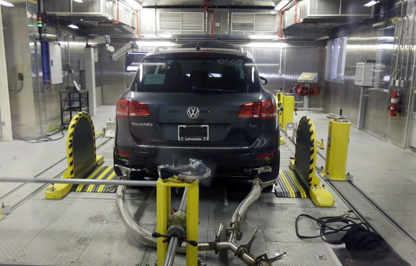 FILE - In this Oct. 13, 2015 file photo, a Volkswagen Touareg diesel is tested in the Environmental Protection Agency's cold temperature test facility in Ann Arbor, Mich. The U.S. government says Volkswagen cheated a second time on emissions tests, programming about 10,000 cars with larger diesel e