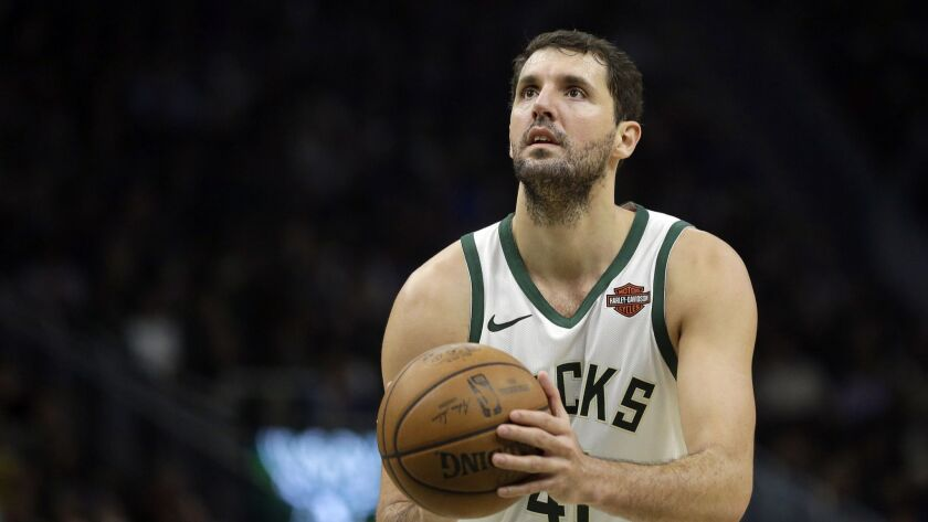 Milwaukee Bucks' Nikola Mirotic shoots a free throw during the second half of an NBA basketball game