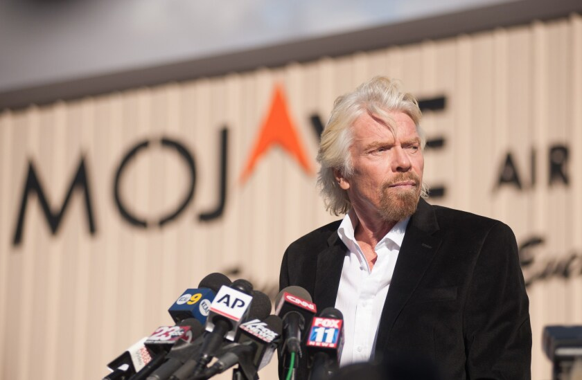 Virgin founder Sir Richard Branson speaks at a news conference at the Mojave Air and Space Port.
