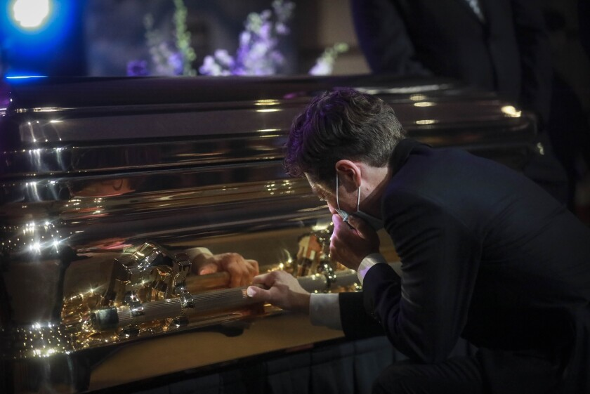 Minneapolis Mayor Jacob Frey kneels and weeps by the casket of George Floyd at North Central University in Minneapolis.