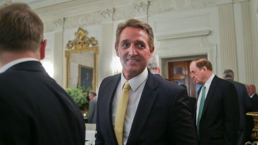 Sen. Jeff Flake (R-Ariz.) attends a luncheon with other GOP senators and President Trump on July 19 at the White House.