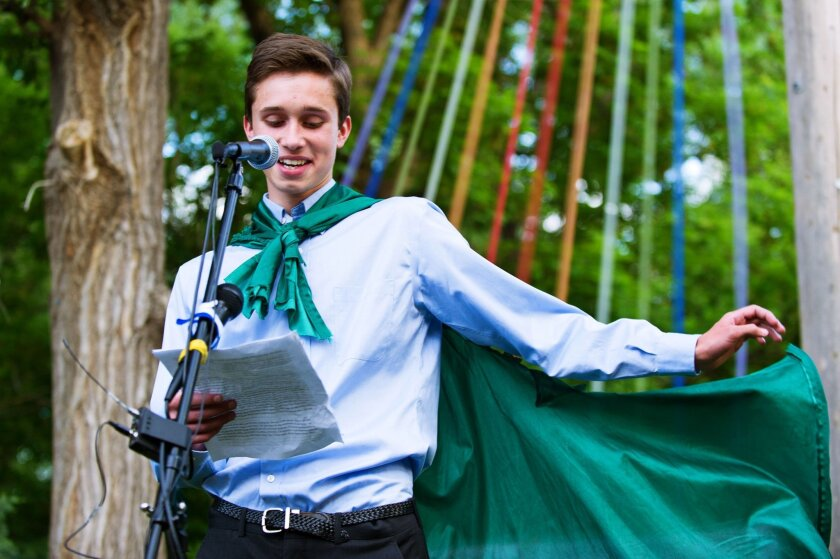 FILE - In this May 31, 2015 file photo, Twin Peaks Charter Academy senior Evan Young reads his valedictorian speech, which he had been barred from reading during Twin Peaks Academy's 2015 commencement ceremony, during an event in in Boulder, Colo., sponsored by the nonprofit Out Boulder. The Twin Peaks Charter Academy, which prevented Young, a gay valedictorian, from coming out during his commencement speech, hired an outside attorney to investigate its decision, who found that the school didn't discriminate by blocking the speech. (Jonathan Castner/The Daily Camera via AP, file)