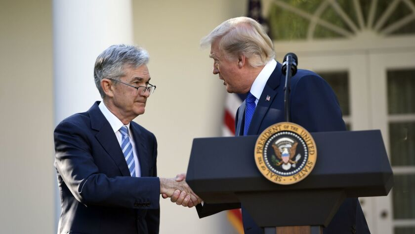 President Trump shakes hands as he announces the nomination of Jerome H. Powell to be chairman of the Federal Reserve.