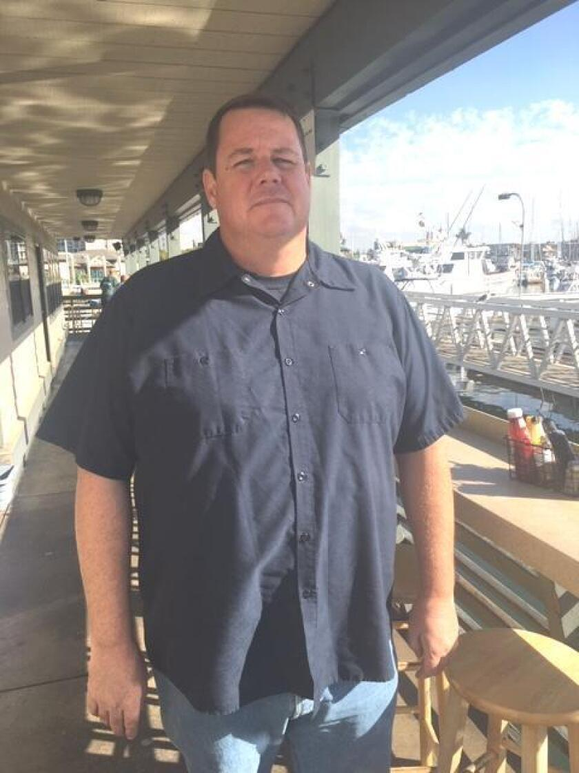 Mitch Conniff on the patio overlooking the waterfront at Mitch's Seafood Restaurant in Point Loma