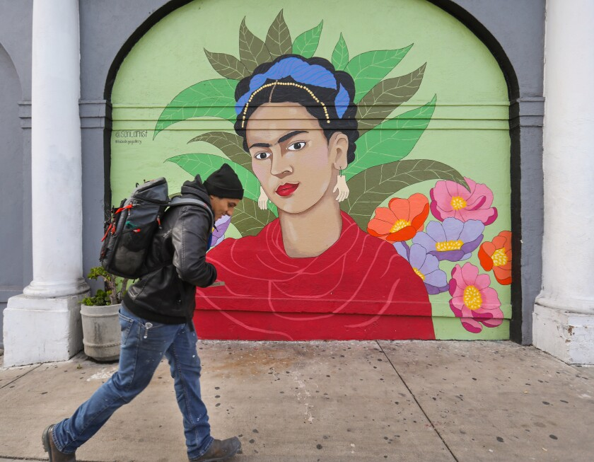 "A pedestrian walks past La Bodega Gallery. It will be the latest gallery to close when it closes by the end of the year, the result of gentrification in the neighborhood, according to local artist Carolyn Osorio, who had exhibited her work at the gallery. This week, the owners of La Bodega announced on Instagram that they have secured a lease a few blocks east on National Avenue. ""Due to the enormity of moving and preparing the new site,"" they wrote, ""it is going to take some time to get the location ready and open. In the meantime we will be collaborating with different venues in San Diego to organize pop-up art shows as our new home is being renovated."""