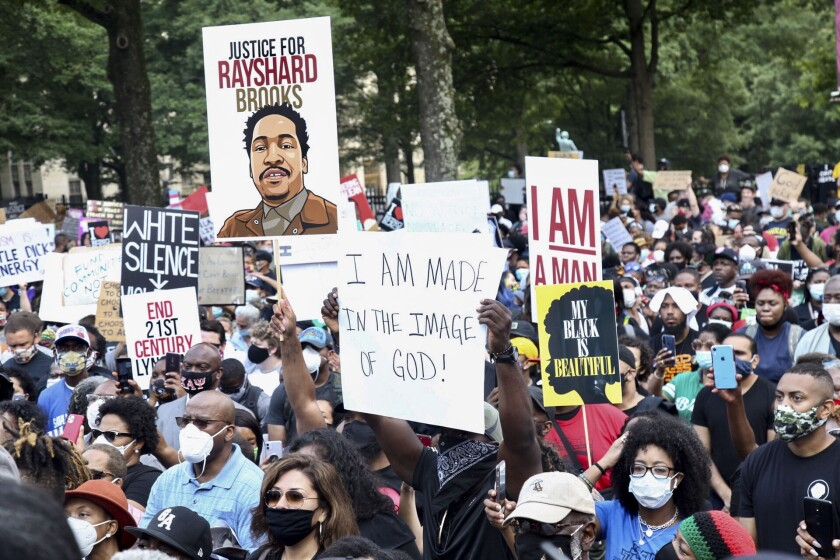 A crowd of demonstrators march to the Capitol Monday, June 15, 2020 in Atlanta. The NAACP March to the Capitol coincided with the restart of the Georgia 2020 General Assembly. Lawmakers returned wearing masks and followed new rules to restart the session during the pandemic. (Steve Schaefer/Atlanta Journal-Constitution via AP)