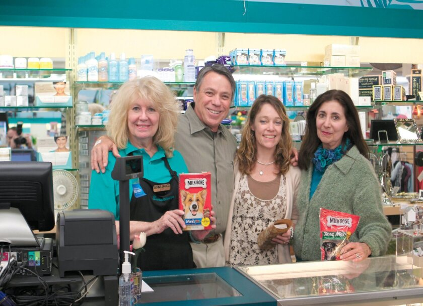 Prior to the store's closing in May 2014, Burns Drugs employee Liz Nelander, owner Wayne Woods, and employees Liz Rogers and Nicole Caulfield shared memories of their time working at the beloved, dog-friendly community pharmacy.
