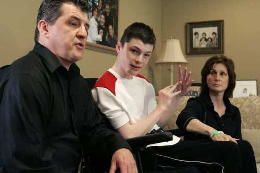 Steven Domalewski, now 18, shown with his parents Joseph and Nancy, was left brain-damaged after being struck by a line drive while playing in a youth baseball game in 2006.