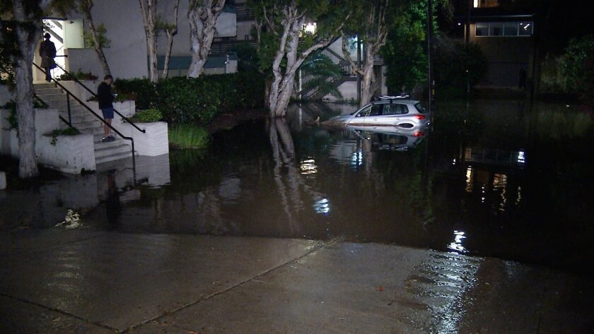 Water surrounds a complex at 917 Torrance St. in Mission Hills / Greg Torkelson/ San Diego News Video