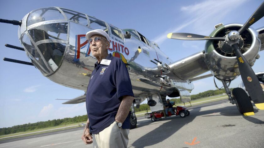 FILE - In this April 16, 2013 file photo, Doolittle Raider Lt. Col. Dick Cole, stands in front of a