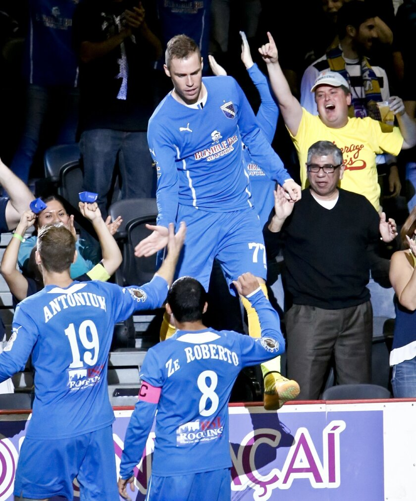 Sockers' Nick Perera jumps onto the boards after scoring the Sockers third goal in the third quarter to tie the game 3-3 against the Las Vegas Legends  on Saturday.