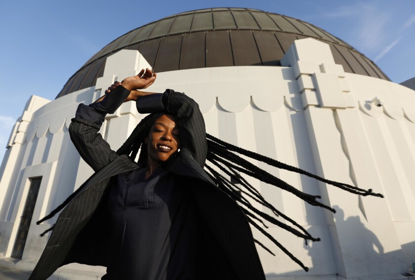 Sudan Archives gets into character as she visits the Griffith Park Observatory on Aug. 24. Sudan is a rising musical sensation, a violinist and singer who mixes R&B and hip-hop with West Africa and Sudanese rhythms.
