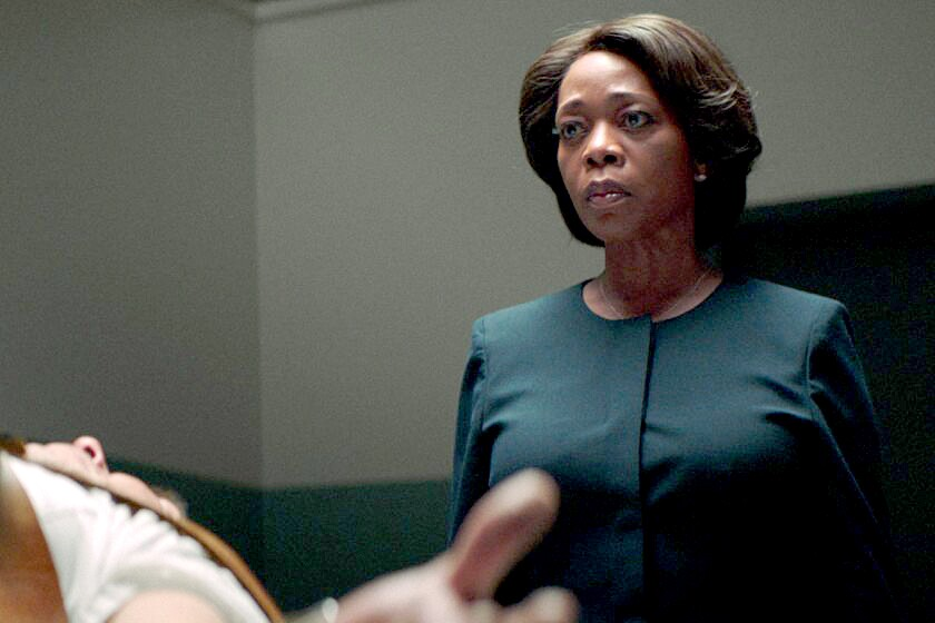 "Alex Castillo and Alfre Woodard in the movie ""Clemency."""