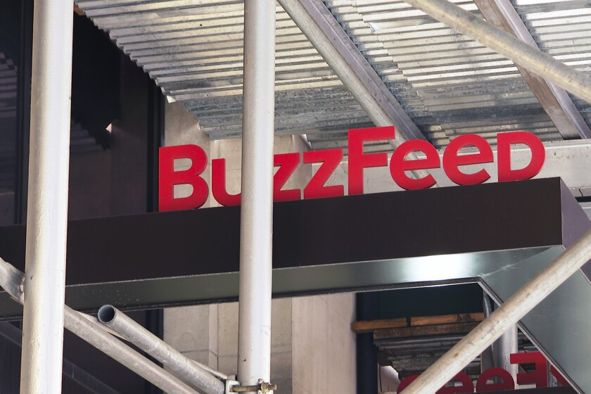 FILE - This Nov. 19, 2020 file photo shows the entrance to BuzzFeed in New York. BuzzFeed is merging with special purpose acquisition company 890 Fifth Avenue Partners Inc., Thursday, June 24, 2021, and will become a publicly traded company. BuzzFeed, which was founded by Jonah Peretti in 2006, said its implied valuation is $1.5 billion, once the transaction closes, which is expected in the fourth quarter. (AP Photo/Ted Shaffrey)