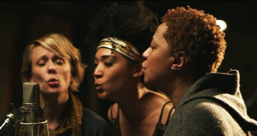 """Jo Lawry, left, Judith Hill and Lisa Fischer make sweet music in """"20 Feet From Stardom,"""" one of 15 movies making the Oscar documentary shortlist."""