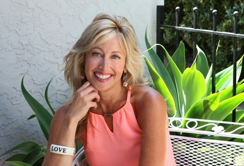 Portrait of Traci Porterfield at her La Costa area home. She's the CEO and founder of Love by Design, which offers matchmaking services and dating coaching.