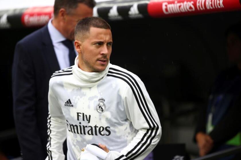 El delantero belga del Real Madrid Eden Hazard momentos antes del inicio del partido de la cuarta jornada de Liga de Primera División, disputado en el estadio Santiago Bernabéu. EFE/Rodrigo Jiménez