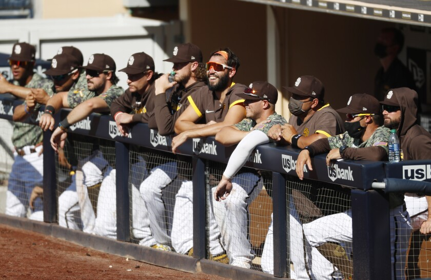 Padres players watch the ninth inning of Sunday's game against the Diamondbacks.