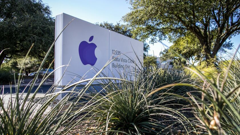 A sign for an existing Apple Inc. office in Austin, Texas. Apple announced it will spend $1 billion on a new campus in North Austin that will initially employ 5,000 and potentially increase to 15,000 workers.