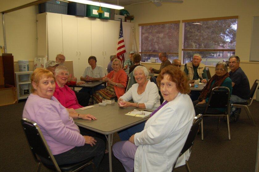 Seniors play bridge in Ramona center.