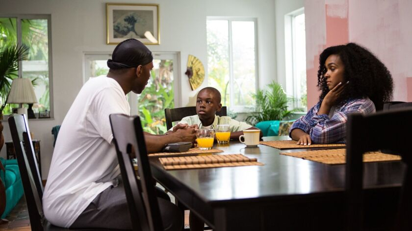 "Mahershala Ali as Juan, Alex R. Hibbert as Little and Janelle Monáe as Teresa in the film ""Moonlight."""