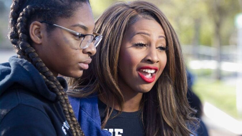 Social-justice activist Aeiramique Glass Blake, right, says a political consulting firm told her it could not work for her congressional campaign because of an edict by the Democratic Congressional Campaign Committee.