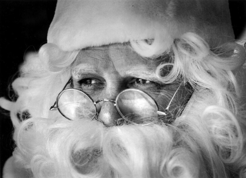 Dec. 20, 1990: Los Angeles Times reporter Bob Pool for his Secret Santa series. In this image here i