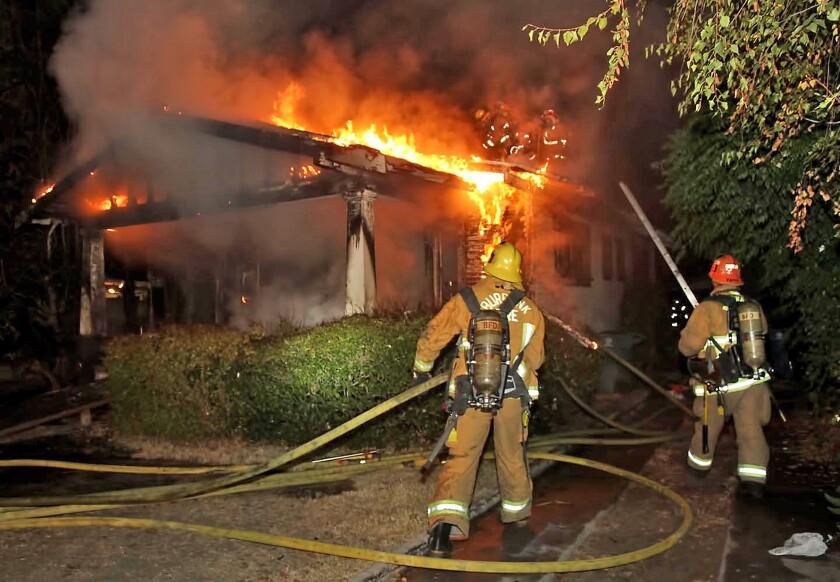 Burbank firefighter battle a house fire at 910 Evergreen Street