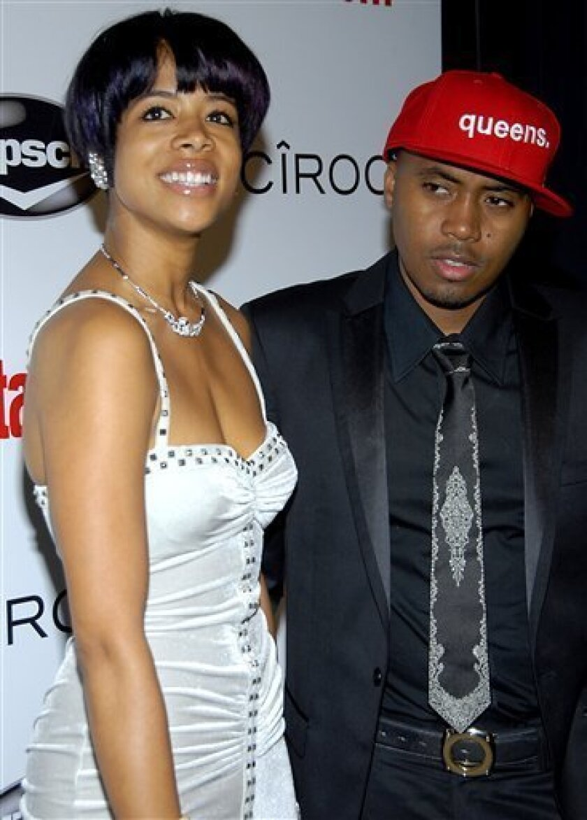 FILE - In this Feb. 10, 2008 file photo, singer Kelis, left, and Nas pose on the press line at the Entertainment Weekly Island Def Jam Grammy party in Los Angeles. (AP Photo/Dan Steinberg, file)