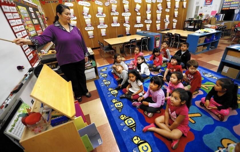 Teacher Celia Cendejas leads preschool students in the School Readiness Language Development Program at Dorris Place Elementary School in Los Angeles.