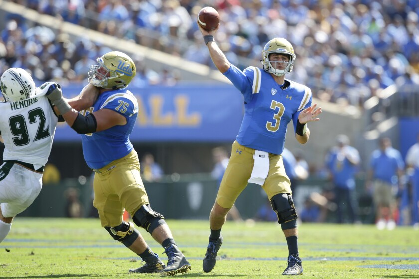 UCLA quarterback Josh Rosen leads the Bruins on a second quarter touchdown drive against Hawaii at the Rose Bowl.