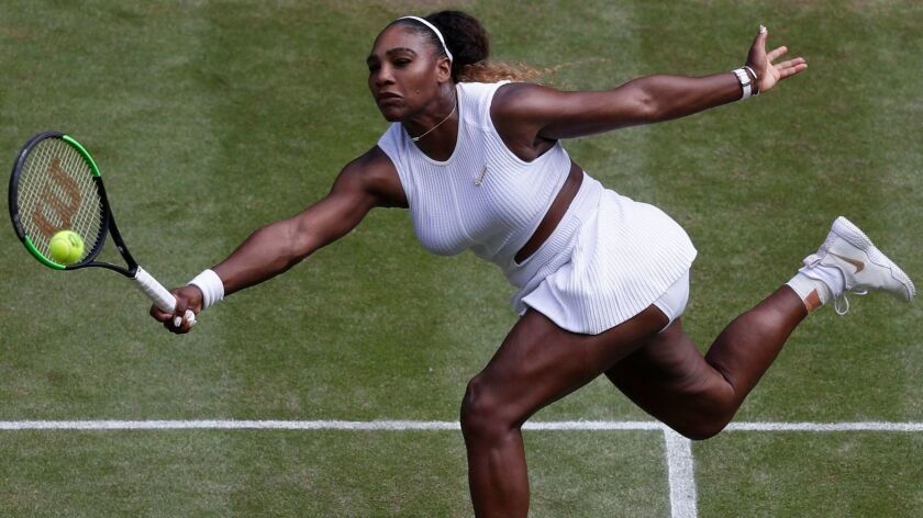 Serena Williams hits a return during a match at Wimbledon in July.