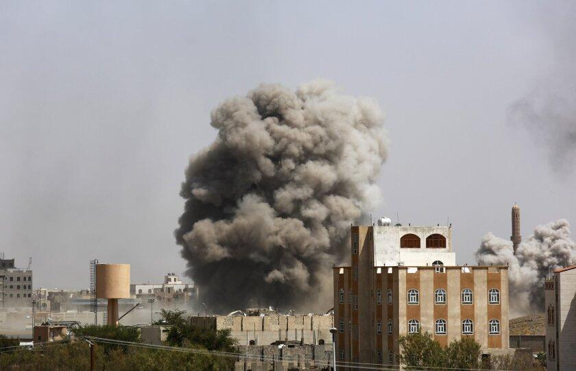 Smoke rises after a Saudi-led airstrike hits an army academy in Sanaa, Yemen, on Sunday.