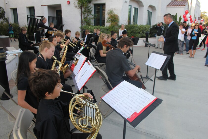 Rowe Music Director RC Haus leads the Eagle band on Red Envelope Day.