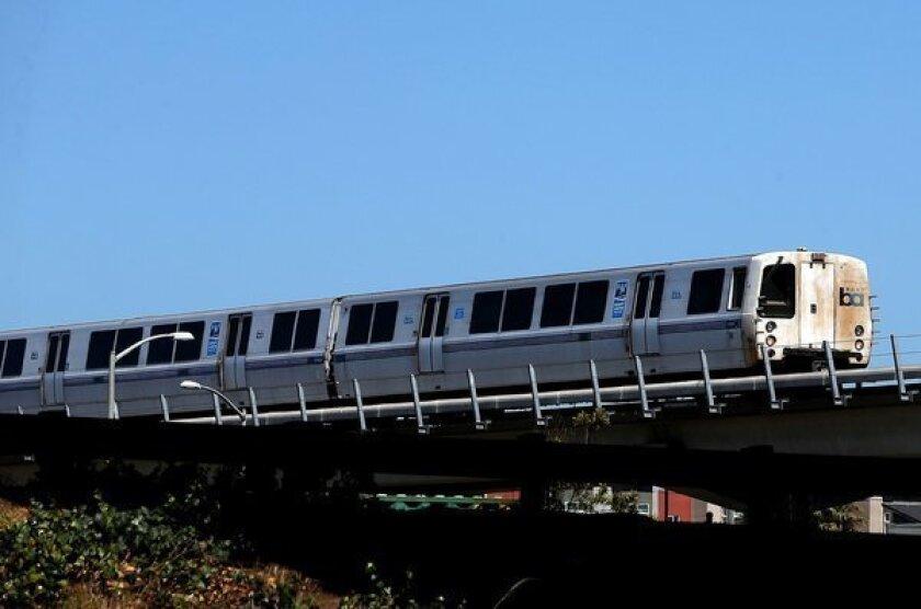 A Bay Area Rapid Transit (BART) train travels toward downtown Oakland.
