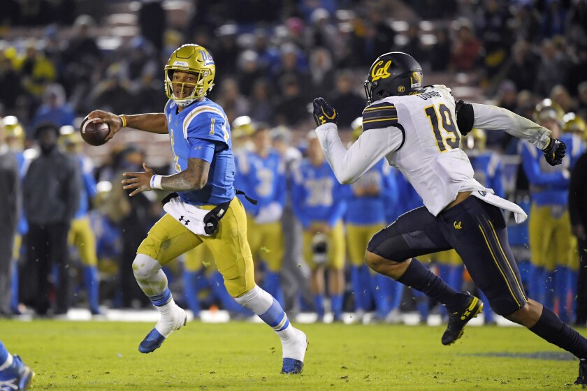 UCLA quarterback Dorian Thompson-Robinson, left, is one of 30 football players who signed the letter of demands sent to UCLA.